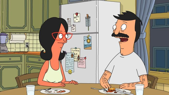 """Bob and a sunburned Linda at their kitchen table in a screenshot from Bob's Burgers, season 10, episode 1, """"The Ring But Not Scary"""""""