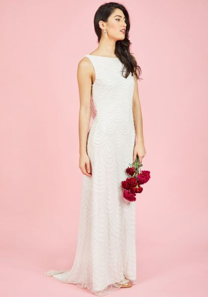 Where to Buy Affordable Wedding Dresses   Racked Model in wedding dress on pink background