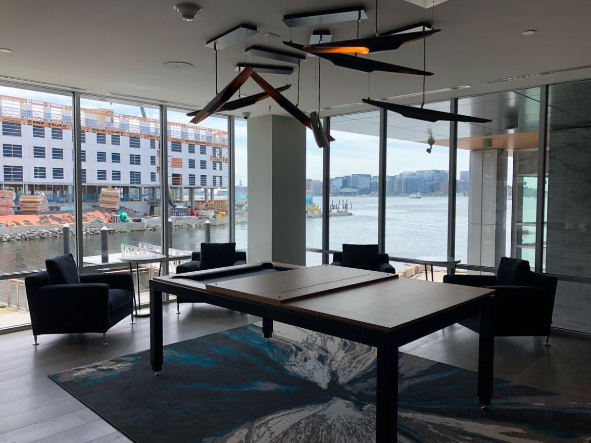 Conference room with board, chairs, and windows overlooking bay.