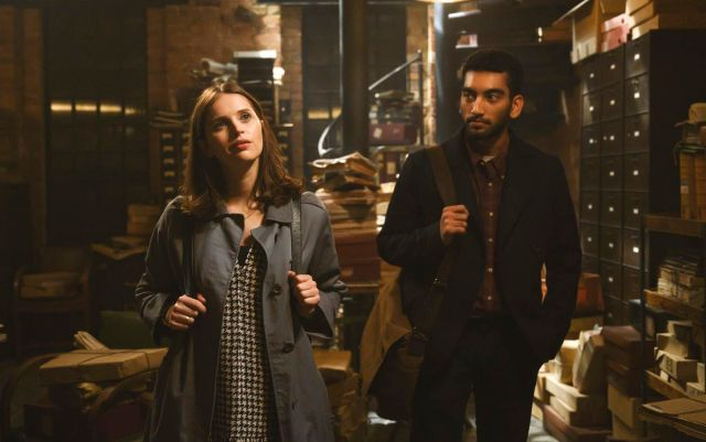 felicity jones in an archive with Nabhaan Rizwan looking at her
