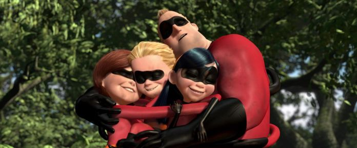 the parr family — mr. incredible, elastigirl, violet, and dash — embrace after a fight
