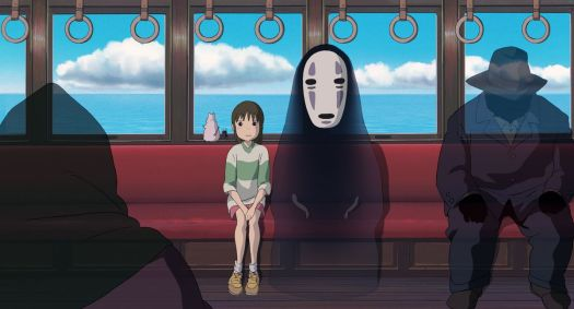 chihiro and no-face on the train in spirited away