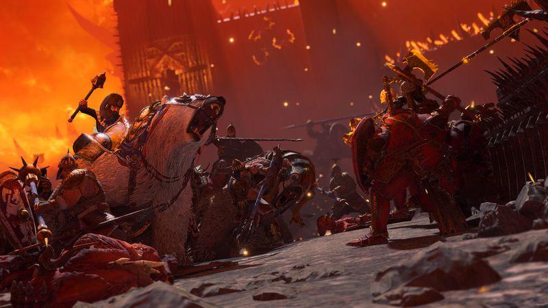 A warrior riding a polar bear goes up against a demon wielding a flaming ax in Total War: Warhammer 3
