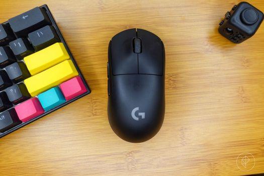 The Logitech G Pro Wireless on a desk near a keyboard and fidget cube
