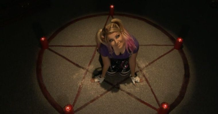 Alexa Bliss, who may have Papa Shango powers, checks on her victim