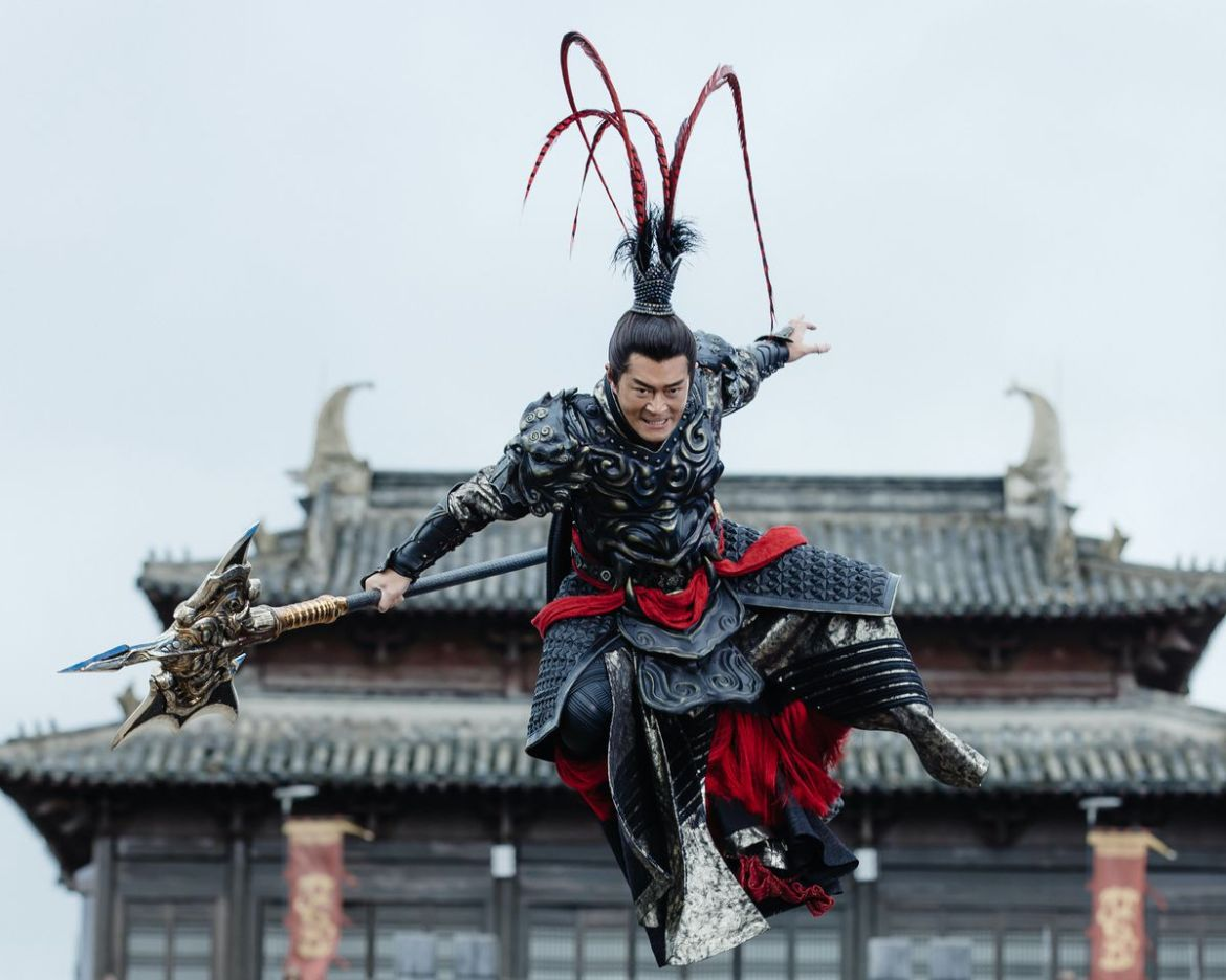 An armored warrior in an elaborate feathered helmet leaps through the air in Netflix's Dynasty Warriors