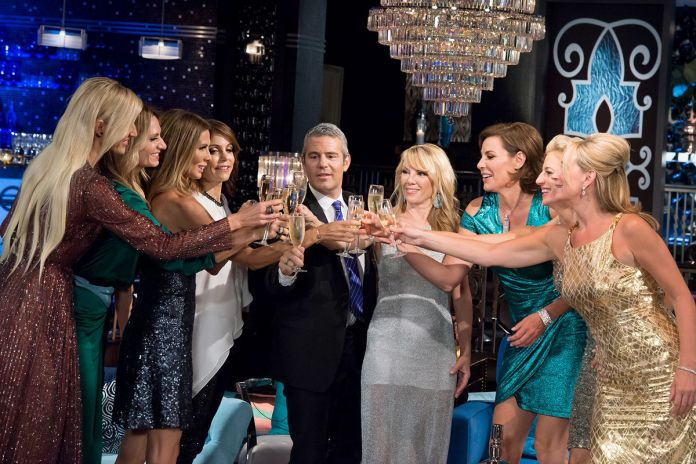 Andy Cohen and the real housewives of new york make a toast