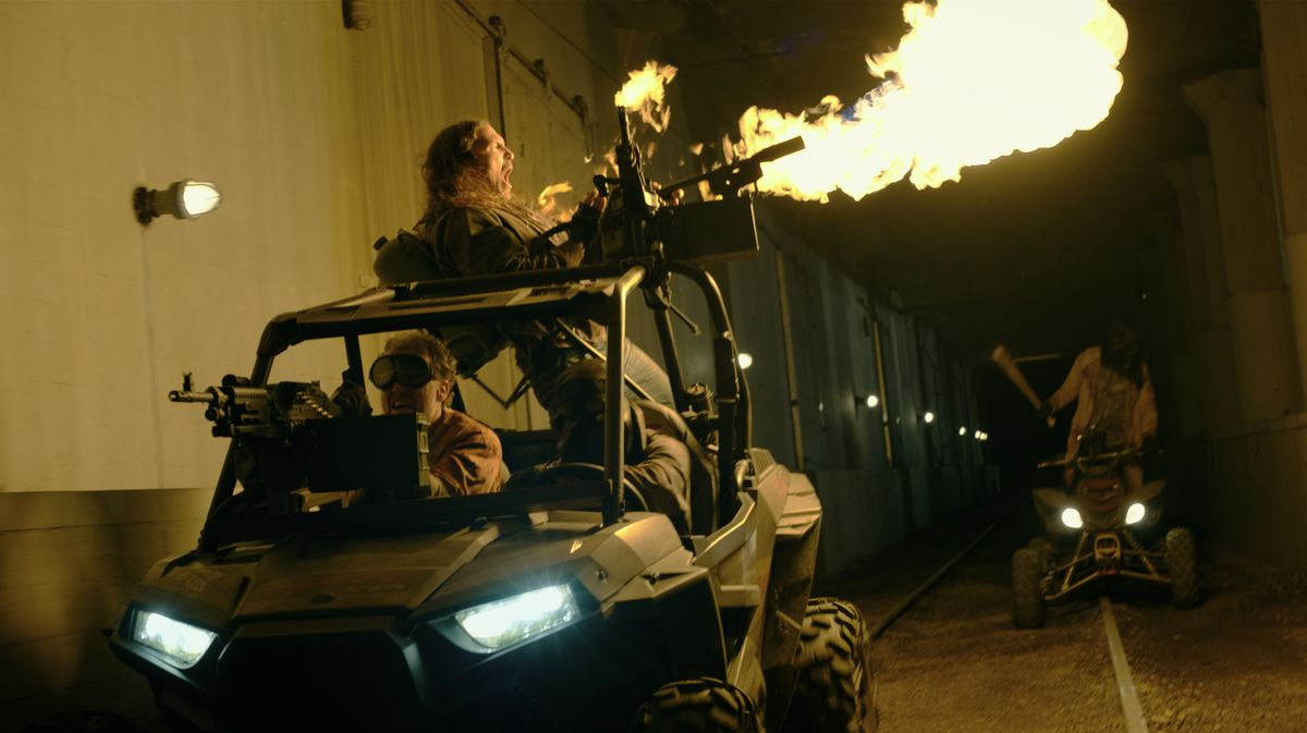 Purgers fire a machine gun atop a buggy in The Forever Purge