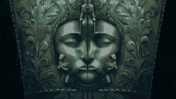 Une grande porte en métal avec un visage sculpté