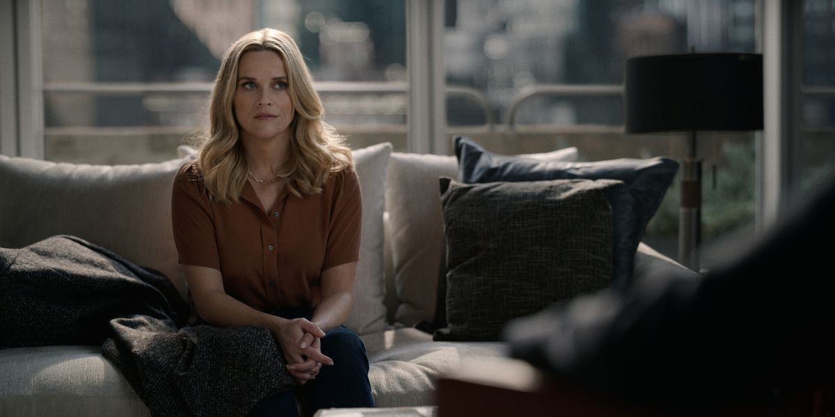 Reese Witherspoon as Bradley Jackson sits on a plush sofa in season 2 of The Morning Show.