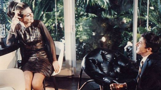 Anne Bancroft and Dennis Hoffman smile at each other in The Graduate