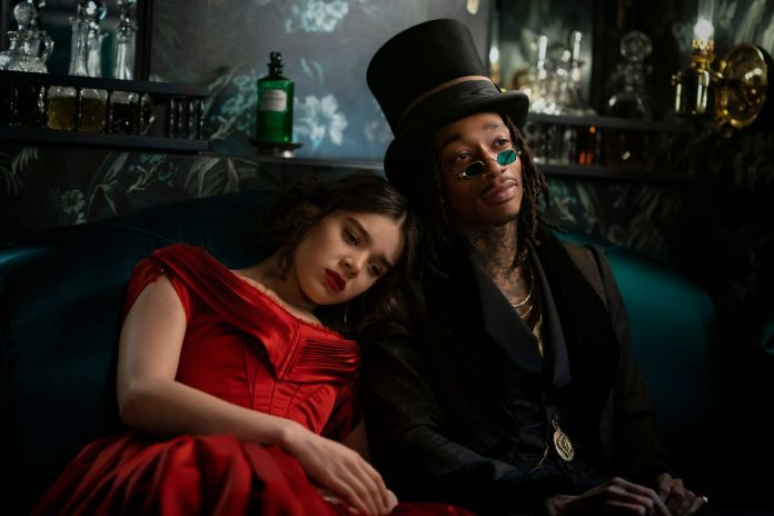 hailee steinfeld's emily leans her head on DEATH's shoulder (as played by wiz khalifa)