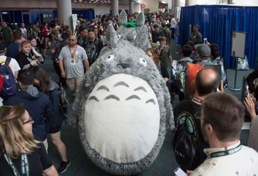 Two people in Totoro costumes walk the hallway during the 2018 San Diego Comic-Con