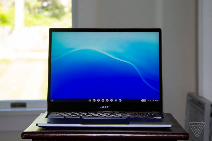 The Acer Chromebook Spin 713 open seen from the front. The screen dispalys a blue gradient.