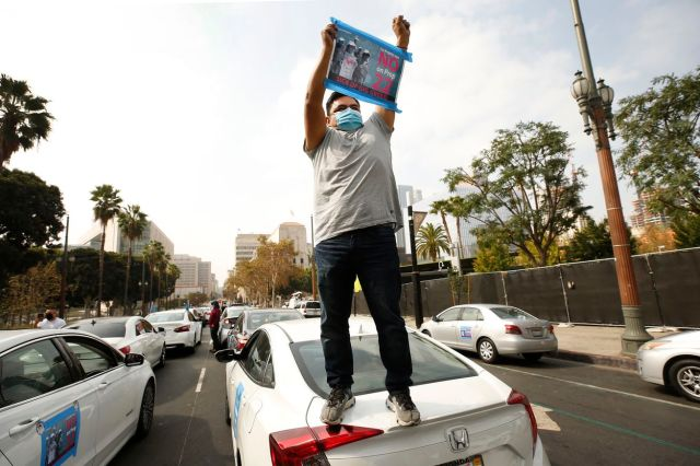 App based gig workers held a driving demonstration with 60-70 vehicles blocking Spring Street in front of Los Angeles City Hall urging voters to vote no on Proposition 22, a November ballot measure that would classify app-based drivers as independent contr