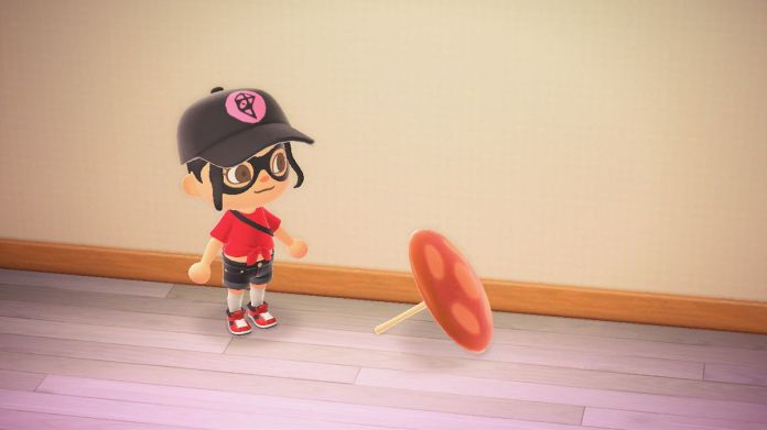 An Animal Crossing character stands next to an umbrella meant to look like a mushroom