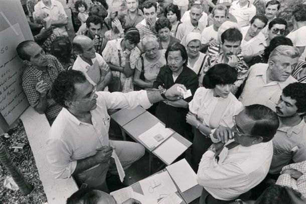 Hundreds of Cuban refugees who came to the United States during the Mariel boat lift apply for permanent resident status, in 1984.