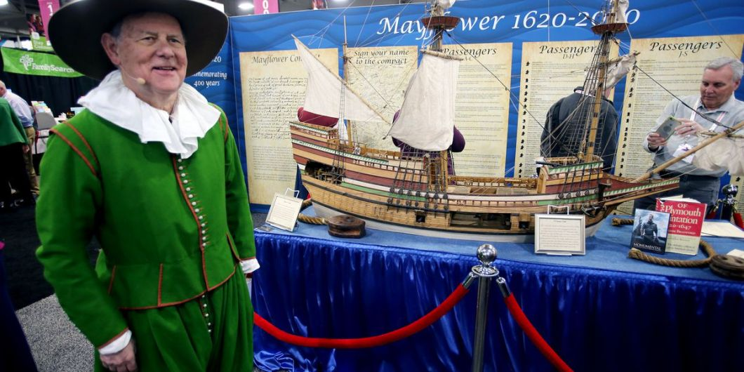 George Garmany, governor general of the General Society of Mayflower Descendants, stands next to a replica of the Mayflower during RootsTech at the Salt Palace Convention Center in Salt Lake City on Friday, Feb. 28, 2020. FamilySearch and the New England Historic Genealogical Society are working together with the General Society of Mayflower Descendants to digitize all of its member applications and publish family trees created from these documented Mayflower lines in order to make them available for free.