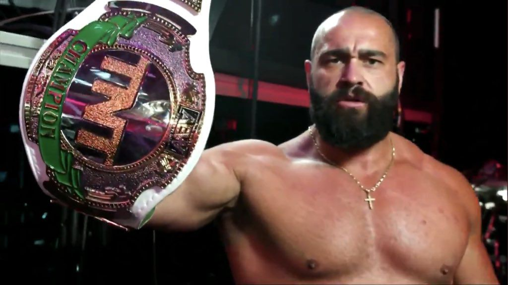 Miro shows off his redesigned TNT title belt