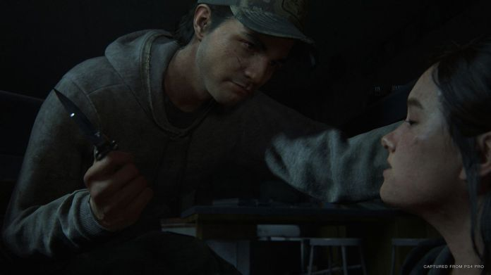 a man menaces Ellie with a knife in The Last of Us Part 2