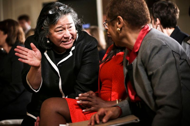 Tina Tchen, then Assistant to President Obama, (left) talks to Rep. Eleanor Holmes Norton (D-DC) during an event marking the 50th anniversary of the Equal Pay Act on June 10, 2013