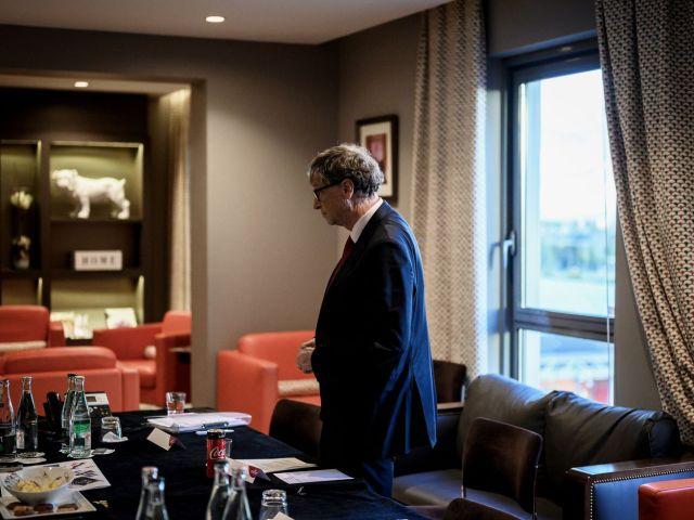 Bill Gates walks in a room.