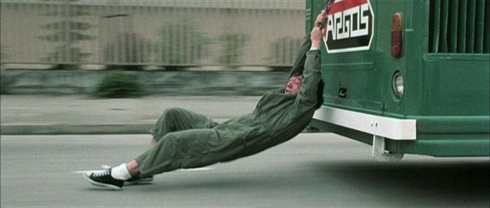 jackie chan holds on to a bus in police story