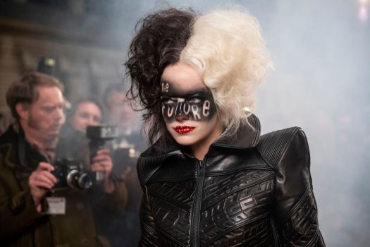 """cruella with the words """"The Future"""" painted across her face"""