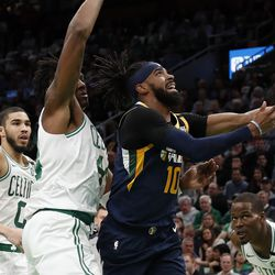 Utah Jazz's Mike Conley (10) goes to the basket past Boston Celtics' Robert Williams III during the first quarter of an NBA basketball game Friday, March 6, 2020, in Boston.