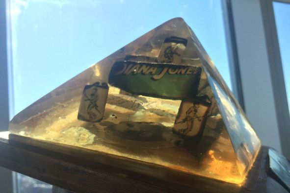 "A Perspex pyramid holding the remains of the ""last"" copy of TSR's Indiana Jones RPG."