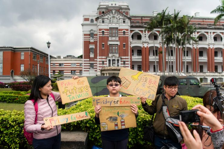 Yang Tzy-Ching, 12, took part in the Global Climate Strike to protest climate change and government inaction in front of the Presidential Palace on March 15, 2019 in Taipei, Taiwan.