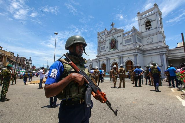 Sri Lankan security forces secure the area around St. Anthony's Shrine after an explosion hit St Anthony's Church in Kochchikade on Sunday in Colombo, Sri Lanka.