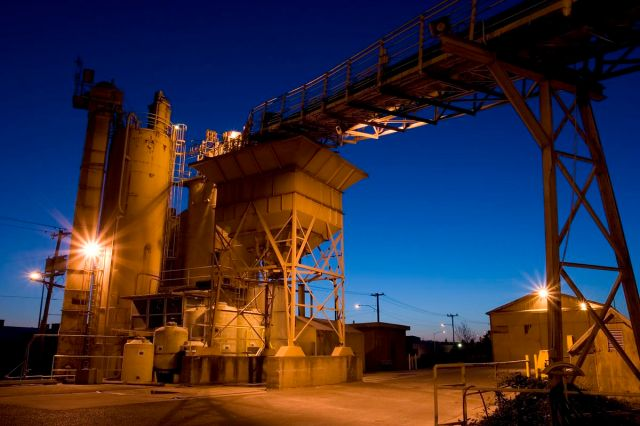 A cement factory at dusk.