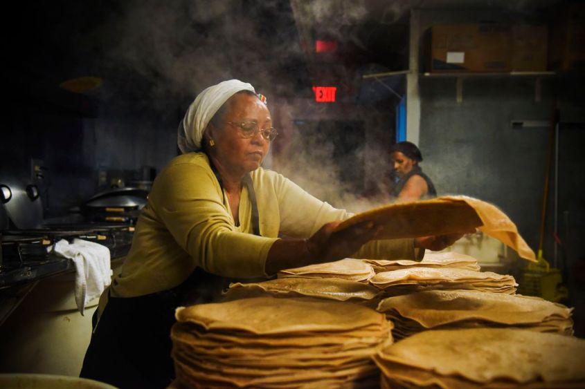 Zenebech Dessu makes injera at her Washington, DC, restaurant Zenebech