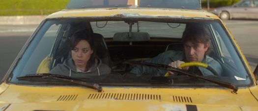 Aubrey Plaza and Mark Duplass sit in a car