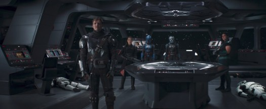 Din Djarin, Fennec Shand, Koska Reeves, Bo-Katan, and Cara Dune stand on the bridge of an Imperial ship in The Mandalorian