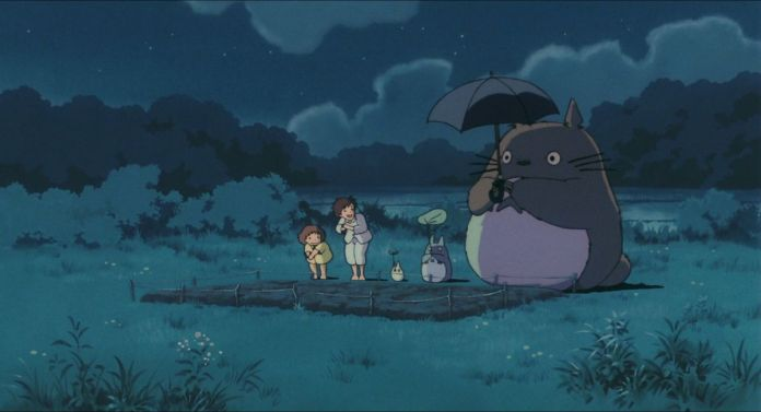 Satsuki, Mei, and three Totoros squat and stretch to grow camphor trees in My Neighbor Totoro