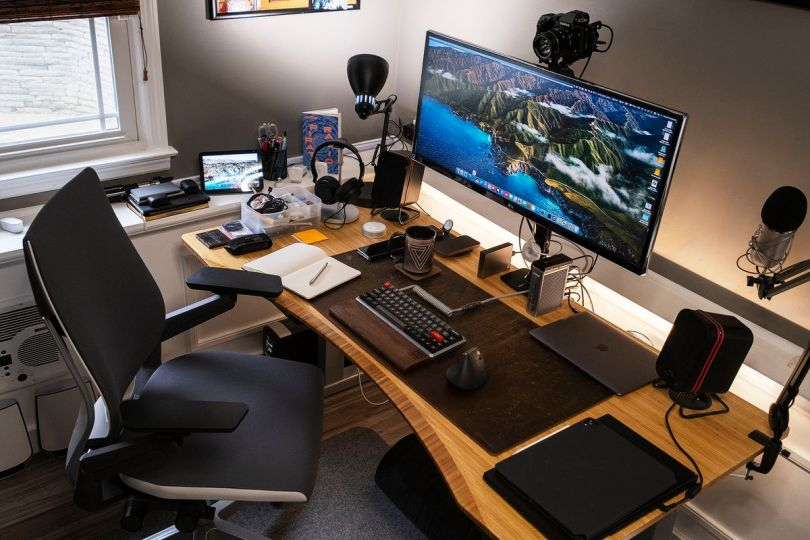 Dan's desk is large enough to have space for multiple devices at the same time.