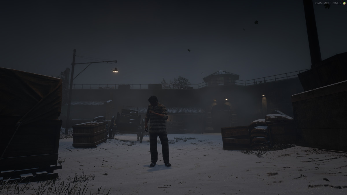 Red Dead Online - a prisoner in a striped uniform stands in the Sisika grounds. It's snowing, and he appears ocld.