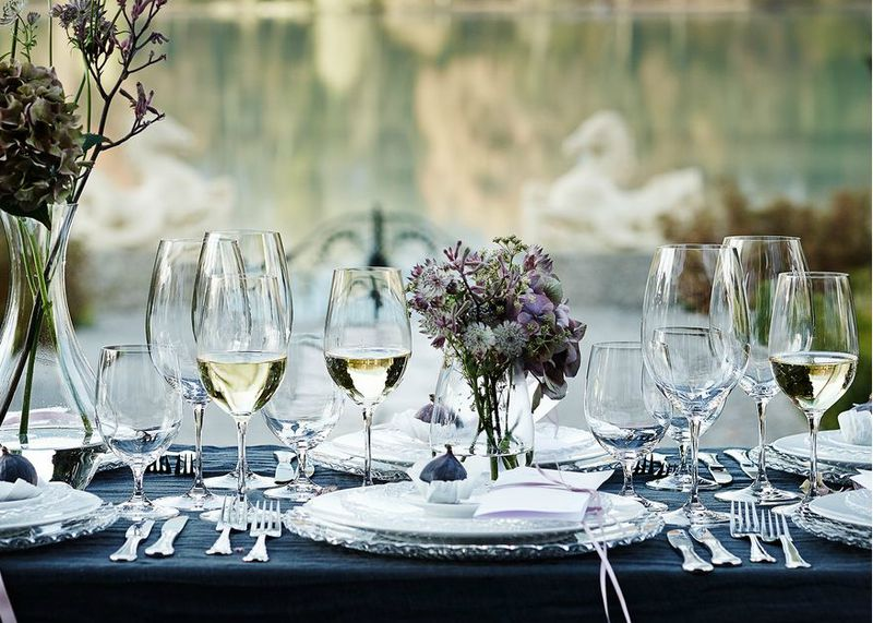 Riedel Vinum glasses on a beautifully set outdoor table