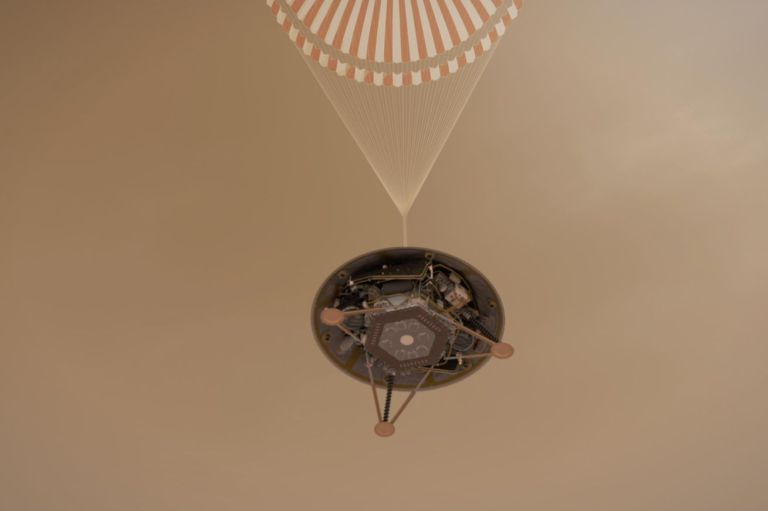 <em>An artistic rendering of NASA's InSight lander with its  supersonic parachute deployed.</em>