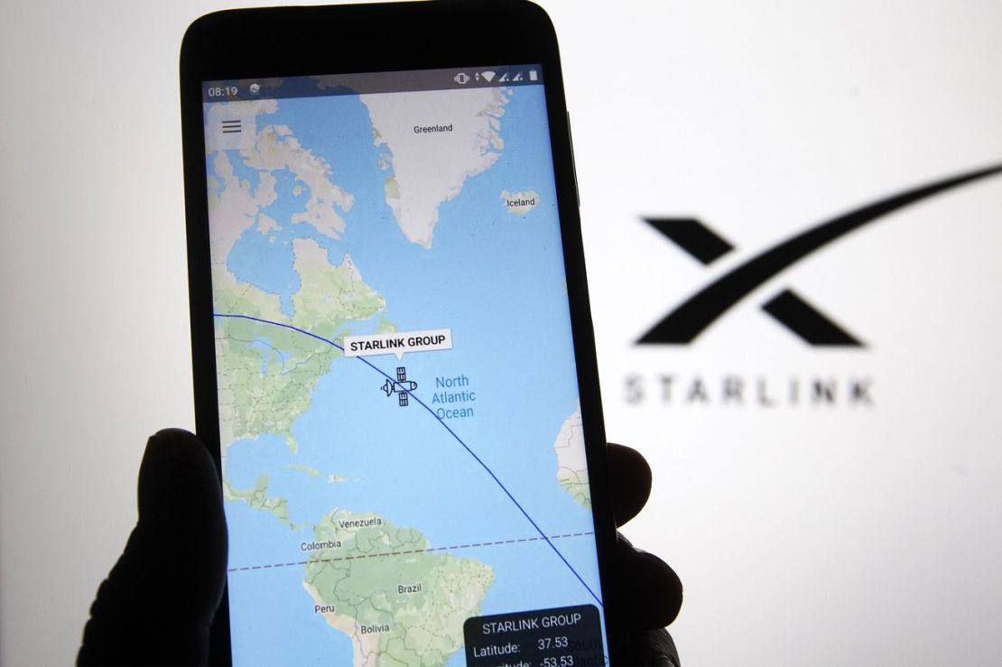 A satellite tracker image is seen displayed on a smartphone...