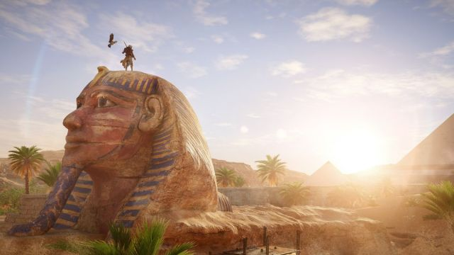 Assassin's Creed Origins - Bayek stands atop a sphinx
