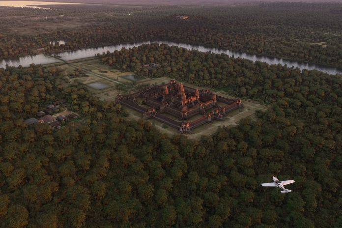 a white plane flies over Cambodia's Angkor Wat in Microsoft Flight Simulator