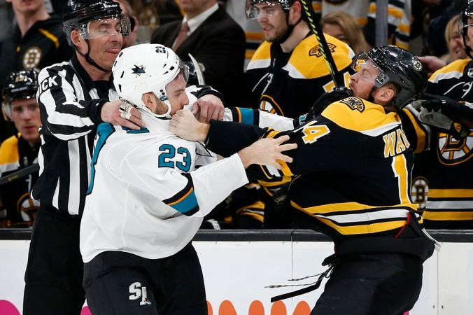 Feb 26, 2019; Boston, MA, USA; San Jose Sharks right wing Barclay Goodrow (23) fights with Boston Bruins right wing Chris Wagner (14) during the second period at TD Garden.
