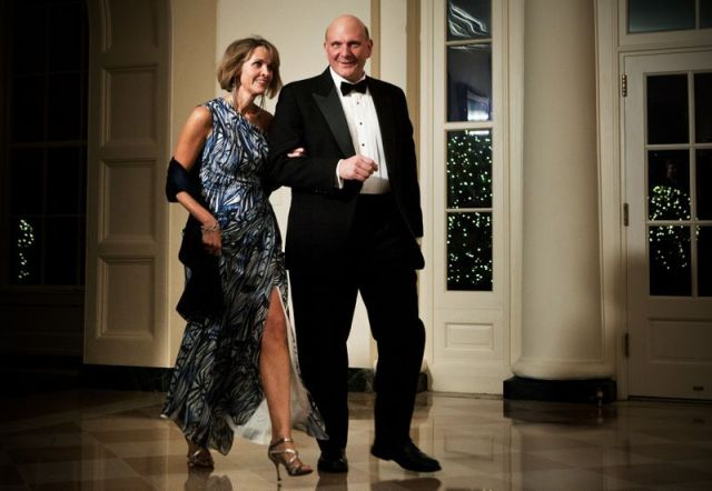 Connie and Steve Ballmer in formal wear walking in the White House.