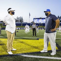 BYU coach Kalani Sitake, right, and Navy coach Ken Niumatalolo meet before the game on Monday, Sept. 7, 2020, at Navy-Marine Corps Memorial Stadium in Annapolis, Maryland.