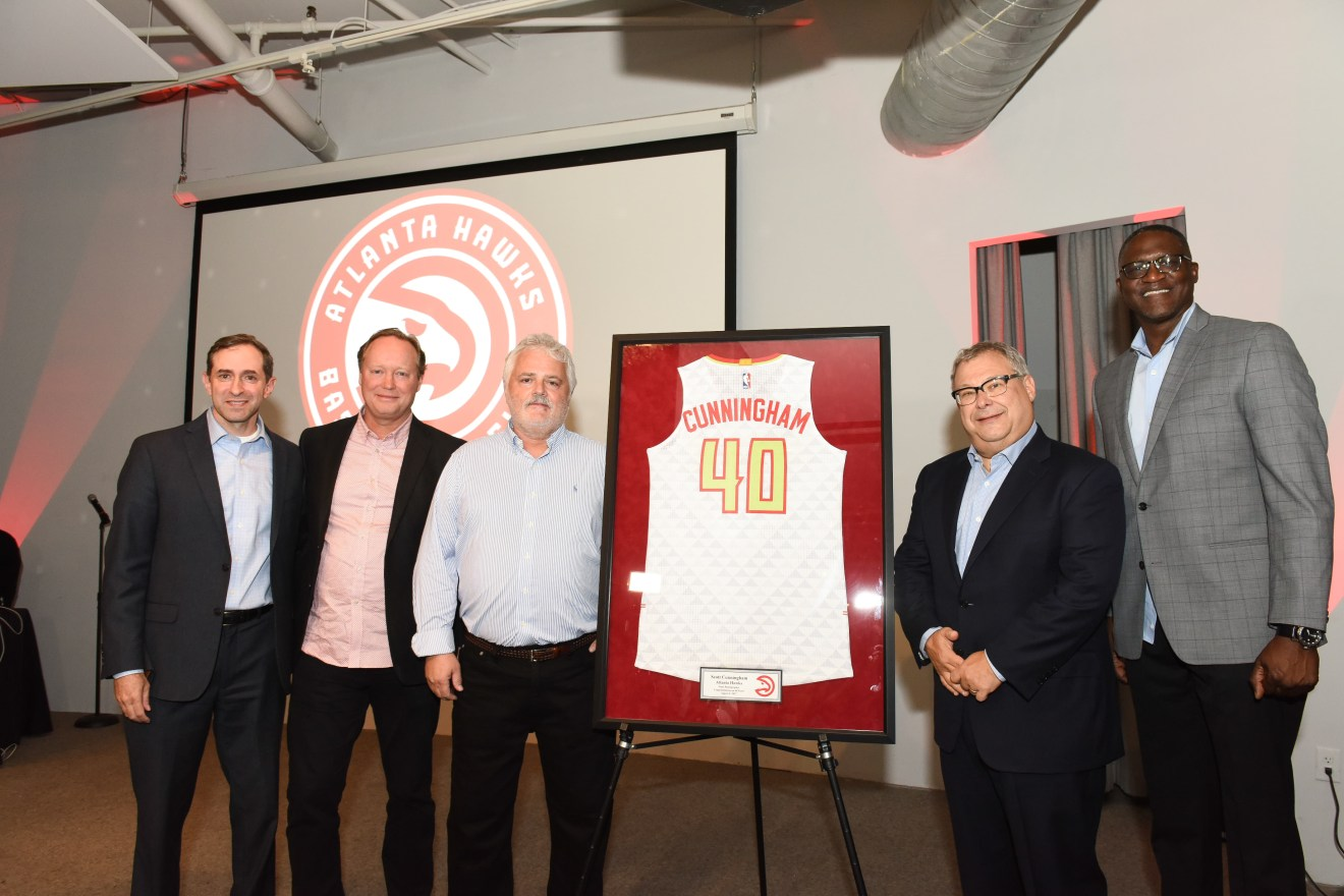 Group photo on stage. Left to right:    Senior Director of Hawks Media Relations Jon Steinberg Atlanta Hawks Head Coach Mike Budenholzer Scott Cunningham Atlanta Hawks CEO Steve Koonin Atlanta Hawks Legend Dominique Wilkins