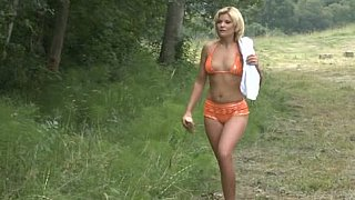 Beautiful blondie gets her ass fucked in forest thumb