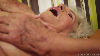 A very hairy granny stimulates her_old clit thumb